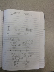 First grade student uses a notebook to make sense of a class model of whale blubber.